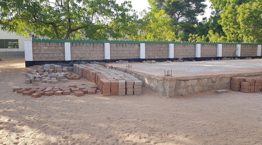 Bricks ready for the construction of the multi-purpose Hall and lined-up near the foundation