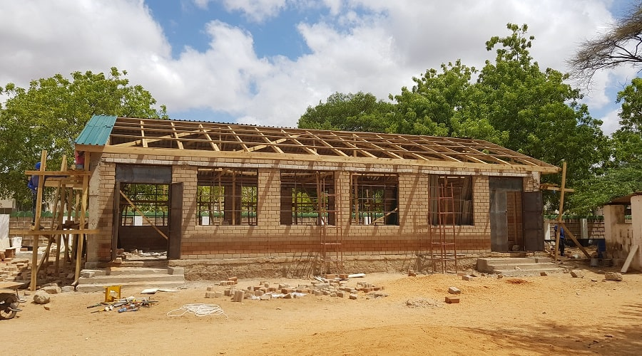 Progress on construction of the multi-purpose Hall in line with all building regulations and completely comparable in durability and structural integrity as with using conventional bricks